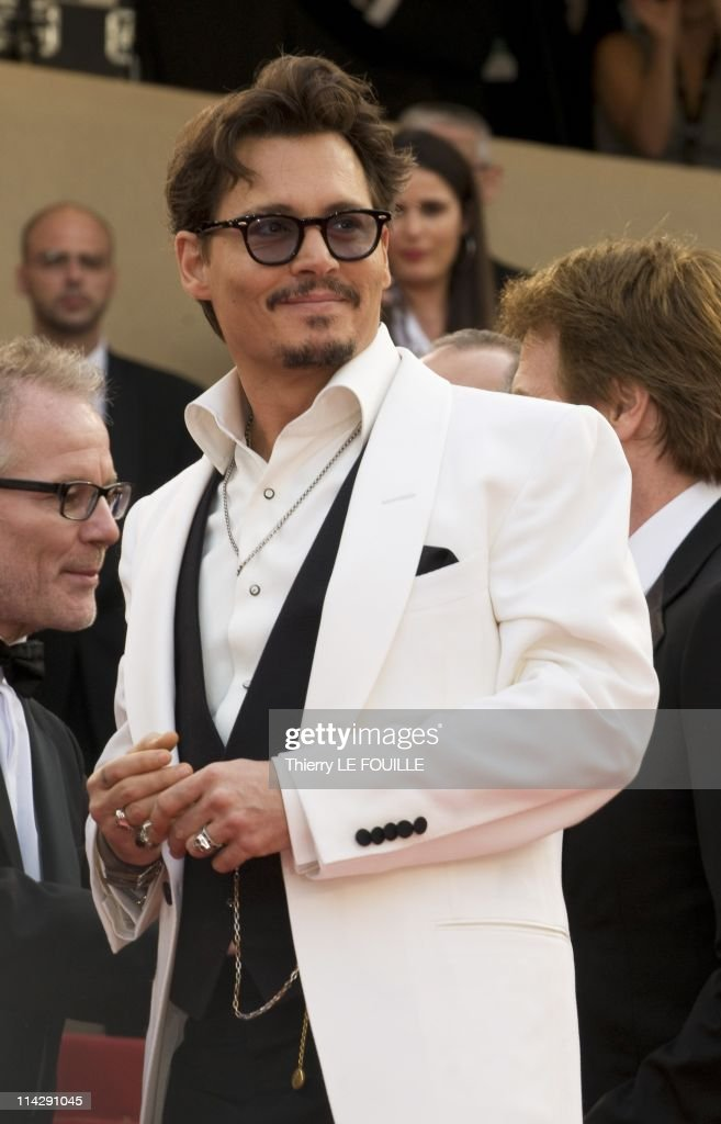 <a gi-track='captionPersonalityLinkClicked' href=/galleries/search?phrase=Johnny+Depp&family=editorial&specificpeople=202150 ng-click='$event.stopPropagation()'>Johnny Depp</a>, arrives at the 'Pirates of the Caribbean: On Stranger Tides' premiere during the 64th Annual Cannes Film Festival at the Palais des Festivals on May 14, 2011 in Cannes, France.