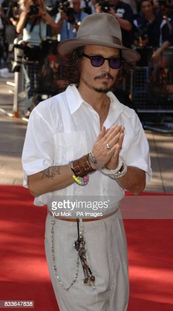 Johnny Depp arrives for the European Premiere of Pirates of the Caribbean Dead Mans Chest at the Odeon Cinema in Leicester Square central London