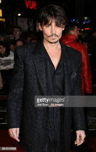 Johnny Depp arrives for the premiere of Sweeney Todd The Demon Barber of Fleet Street at the Odeon West End Cinema Leicester Square London