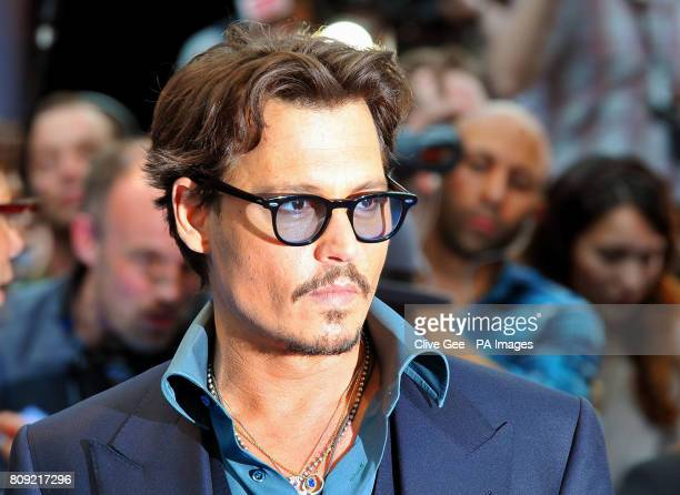Johnny Depp arrives for the UK film premiere of Pirates of the Caribbean On Stranger Tides at the Vue Westfield in west London
