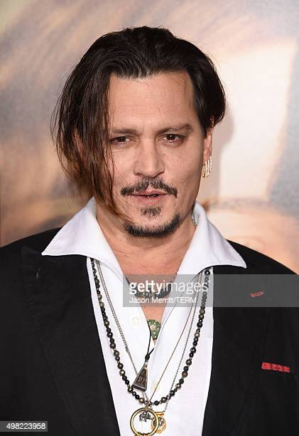 Johnny Depp attends the premiere of Focus Features' 'The Danish Girl' at Westwood Village Theatre on November 21 2015 in Westwood California