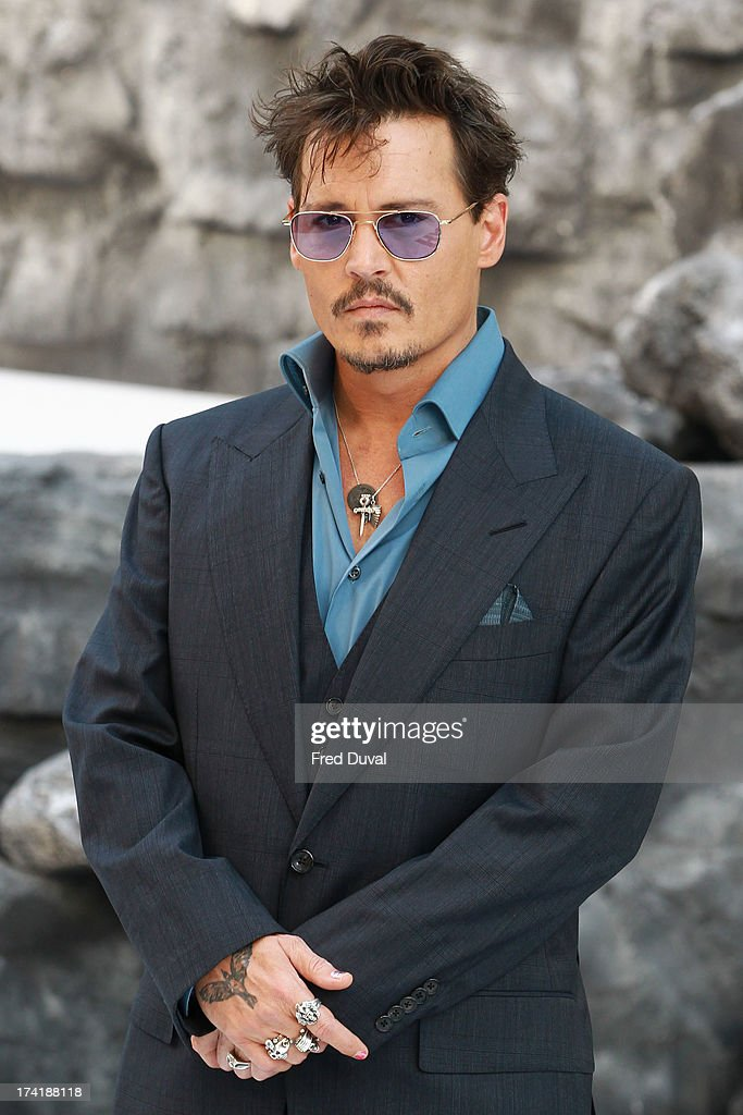 <a gi-track='captionPersonalityLinkClicked' href=/galleries/search?phrase=Johnny+Depp&family=editorial&specificpeople=202150 ng-click='$event.stopPropagation()'>Johnny Depp</a> attends the premiere of 'The Lone Ranger' at Odeon Leicester Square on July 21, 2013 in London, England.