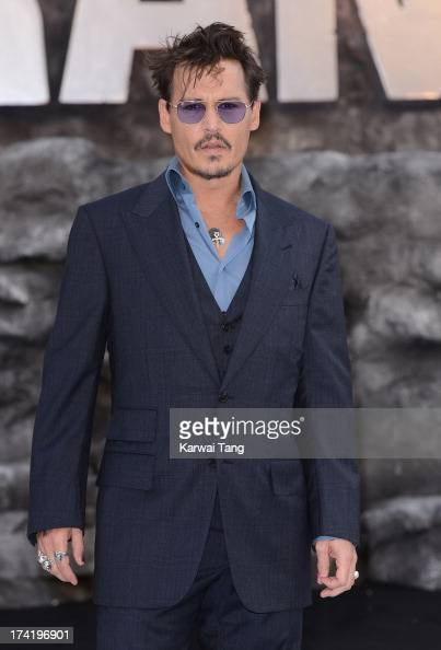 Johnny Depp attends the UK Premiere of 'The Lone Ranger' at Odeon Leicester Square on July 21 2013 in London England