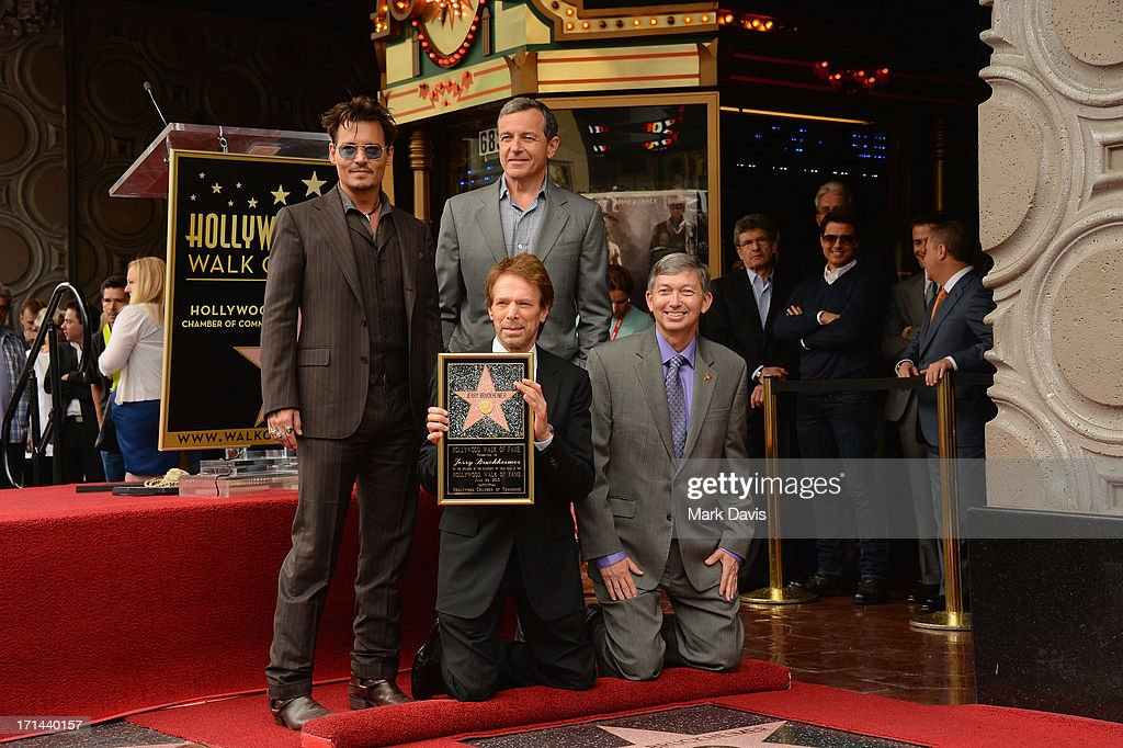 Johnny Depp, Bob Iger, The Walt Disney Company, Chairman and CEO, (L-R, front row) Jerry Bruckheimer and Hollywood Chamber of Commerce, President/CEO Leron Gubler pose as Bruckheimer is honored on the Hollywood Walk Of Fame on June 24, 2013 in Hollywood, California.