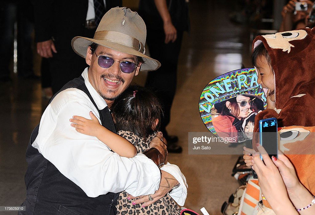 <a gi-track='captionPersonalityLinkClicked' href=/galleries/search?phrase=Johnny+Depp&family=editorial&specificpeople=202150 ng-click='$event.stopPropagation()'>Johnny Depp</a> is greeted by a young fan as he arrives at Narita International Airport on July 16, 2013 in Narita, Japan.