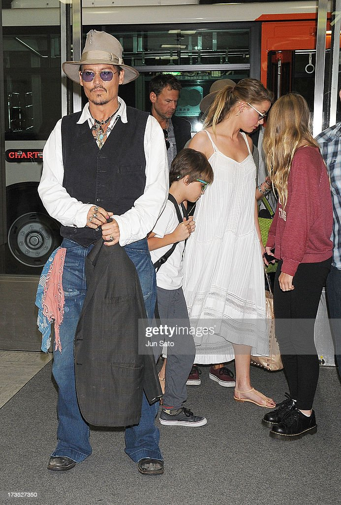 <a gi-track='captionPersonalityLinkClicked' href=/galleries/search?phrase=Johnny+Depp&family=editorial&specificpeople=202150 ng-click='$event.stopPropagation()'>Johnny Depp</a>, Jack Depp, <a gi-track='captionPersonalityLinkClicked' href=/galleries/search?phrase=Amber+Heard&family=editorial&specificpeople=2210577 ng-click='$event.stopPropagation()'>Amber Heard</a> and Lily Rose Melody Depp arrive at Narita International Airport on July 16, 2013 in Narita, Japan.