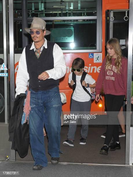 Johnny Depp Jack Depp and Lily Rose Melody Depp arrive at Narita International Airport on July 16 2013 in Narita Japan