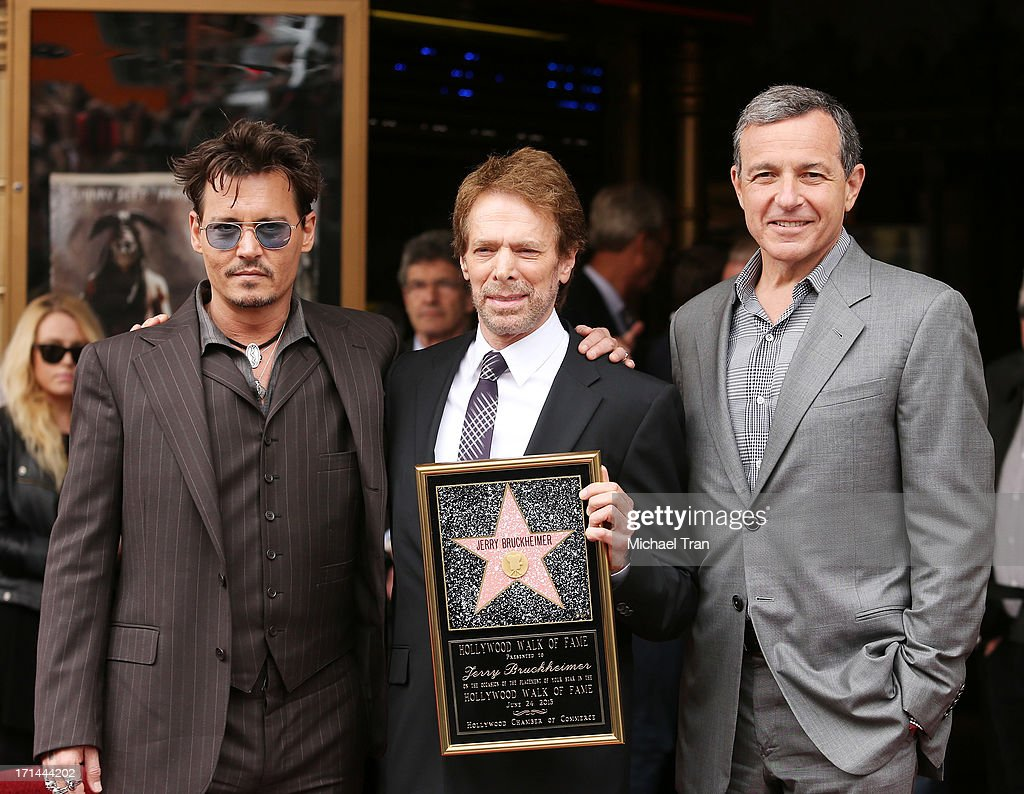 Johnny Depp, Jerry Bruckheimer and Bob Iger attend the ceremony honoring Jerry Bruckheimer with a Star on The Hollywood Walk of Fame held in front of El Capitan Theatre on June 24, 2013 in Hollywood, California.