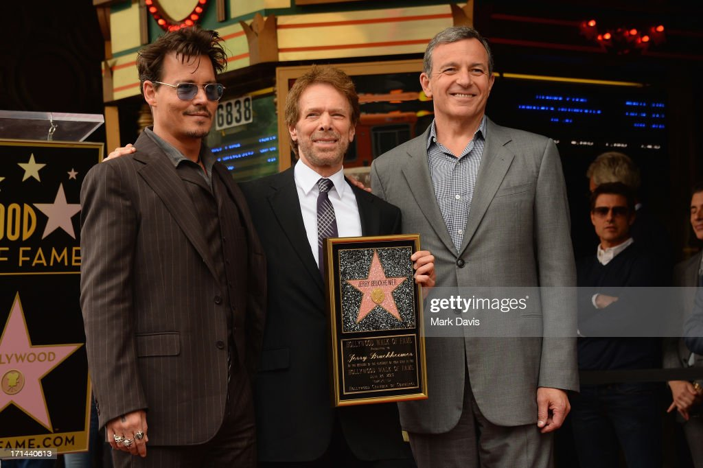 Johnny Depp, Jerry Bruckheimer and Bob Iger, The Walt Disney Company, Chairman and CEO pose as Bruckheimer is honored on the Hollywood Walk Of Fame on June 24, 2013 in Hollywood, California.