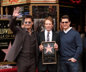 Johnny Depp Jerry Bruckheimer and Tom Cruise attend the ceremony honoring Jerry Bruckheimer with a Star on The Hollywood Walk of Fame held in front...