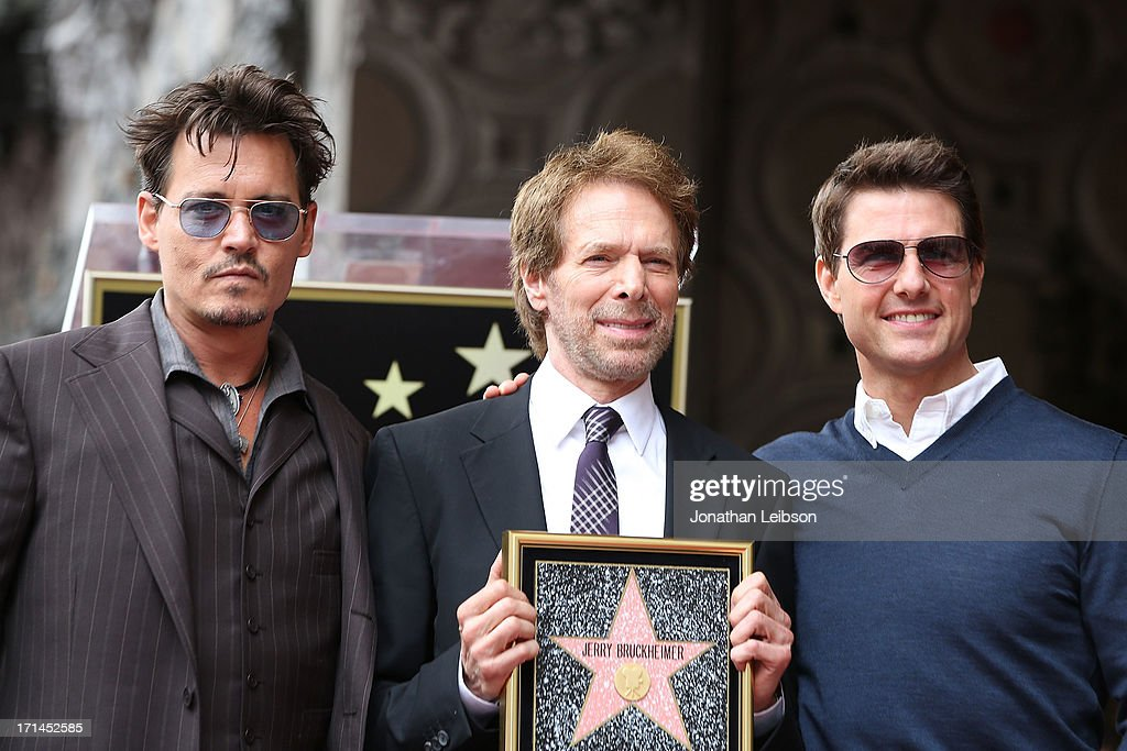Johnny Depp, Jerry Bruckheimer and Tom Cruise attend the ceremony honoring Jerry Bruckheimer with a Star on The Hollywood Walk of Fame held in front of El Capitan Theatre on June 24, 2013 in Hollywood, California.