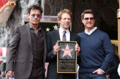 Johnny Depp Jerry Bruckheimer and Tom Cruise pose as Jerry Bruckheimer is honored on the Hollywood Walk Of Fame on June 24 2013 in Hollywood...