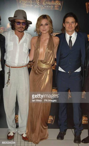 Johnny Depp Keira Knightley and Orlando Bloom arrive for the European Premiere of Pirates of the Caribbean Dead Man's Chest at the Odeon Cinema in...