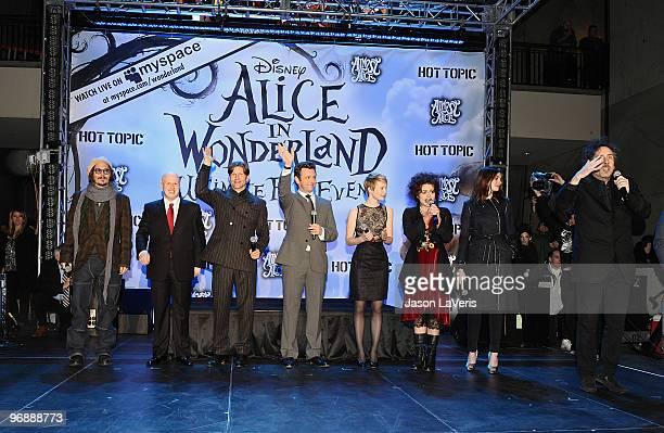 Johnny Depp Matt Lucas Crispin Glover Michael Sheen Mia Wasikowska Helena Bonham Carter Anne Hathaway and Tim Burton attend the 'Alice In Wonderland'...