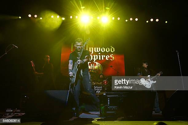 Johnny Depp Matt Sorum and Joe Perry of Hollywood Vampires perform at Ford Ampitheater at Coney Island Boardwalk on July 10 2016 in Brooklyn New York