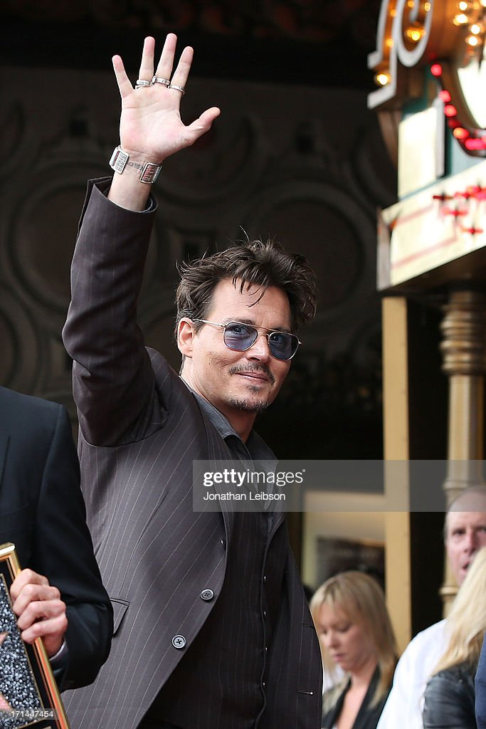Johnny Depp poses as Jerry Bruckheimer is honored on the Hollywood Walk Of Fame on June 24, 2013 in Hollywood, California.