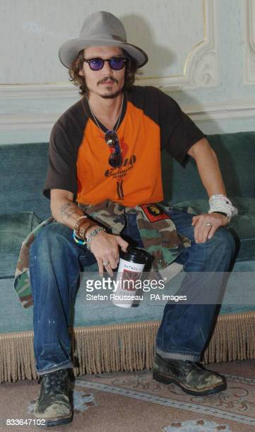 Johnny Depp poses for photographs after holding a press conference to promote his new film Pirates Of The Carribean Dead Man's Chest at Claridges...