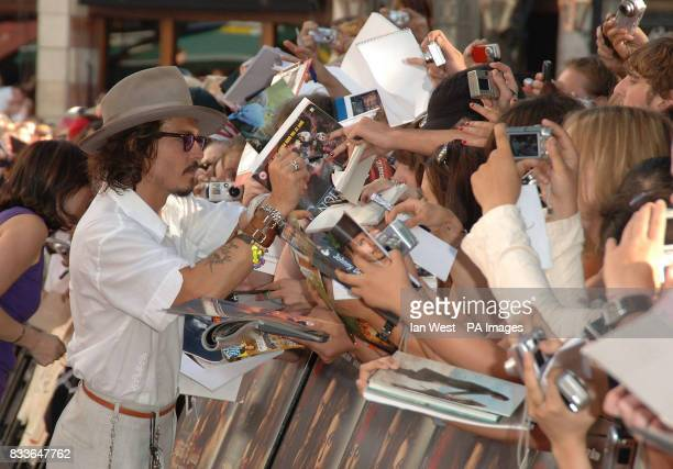 Johnny Depp signs autographs at the European Premiere of Pirates of the Caribbean Dead Man's Chest at the Odeon Cinema in Leicester Square central...