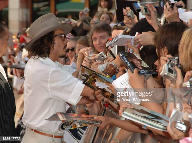 Johnny Depp signs autographs at the European Premiere of Pirates of the Caribbean Dead Mans Chest at the Odeon Cinema in Leicester Square central...