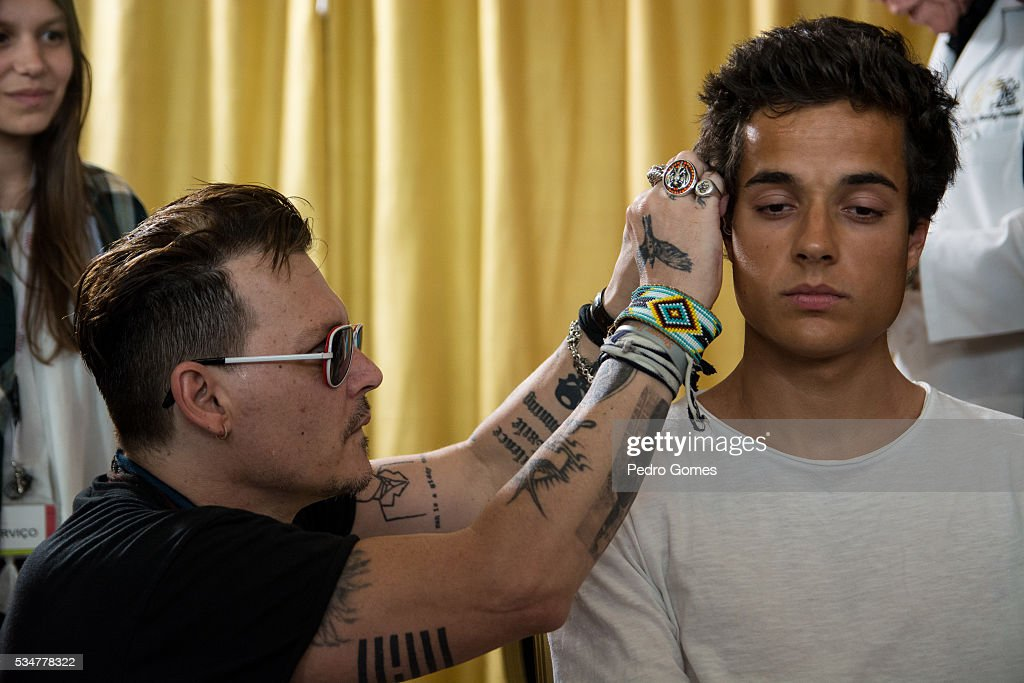 <a gi-track='captionPersonalityLinkClicked' href=/galleries/search?phrase=Johnny+Depp&family=editorial&specificpeople=202150 ng-click='$event.stopPropagation()'>Johnny Depp</a> with a patient of the Starkey Hearing Foundation at Four Season Hotel Ritz Lisbon on May 27, 2016 in Lisbon, Portugal.