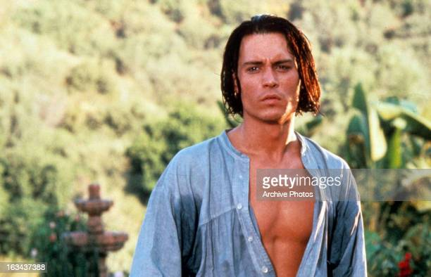 Johnny Depp with shirt open outside in a scene from the film 'Don Juan DeMarco' 1994