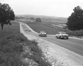 Johnny Dodson leads fellow Chevrolet driver Gwyn Staley on an uphill portion of the road course at Road America during the NASCAR Cup race