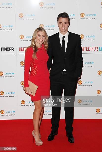 Johnny Evans and Kate Wathall attend the United for UNICEF Gala Dinner at Old Trafford on December 19 2012 in Manchester England