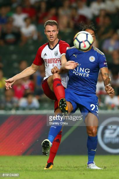 Johnny Evans of West Bromwich Albion competes with Leonardo Ulloa of Leicester City during the Premier League Asia Trophy match between Leicester...
