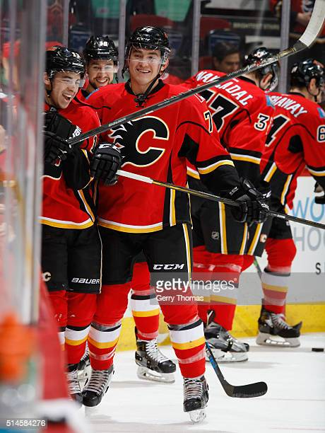 Johnny Gaudreau and Micheal Ferland of the Calgary Flames have some fun in warm up prior to the game against the Nashville Predators at Scotiabank...