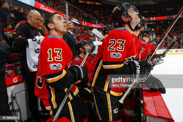Johnny Gaudreau and Sean Monahan of the Calgary Flames looks at the replay in an NHL game against the St Louis Blues at the Scotiabank Saddledome on...