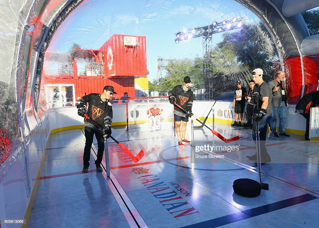 Johnny Gaudreau, Dylan Larkin and Ryan Nugent-Hopkins of Team North America play bubble hockey at the Scotiabank Fan Village prior to it's opening as part of the World Cup of Hockey festivities on September 15, 2016 in Toronto, Canada.