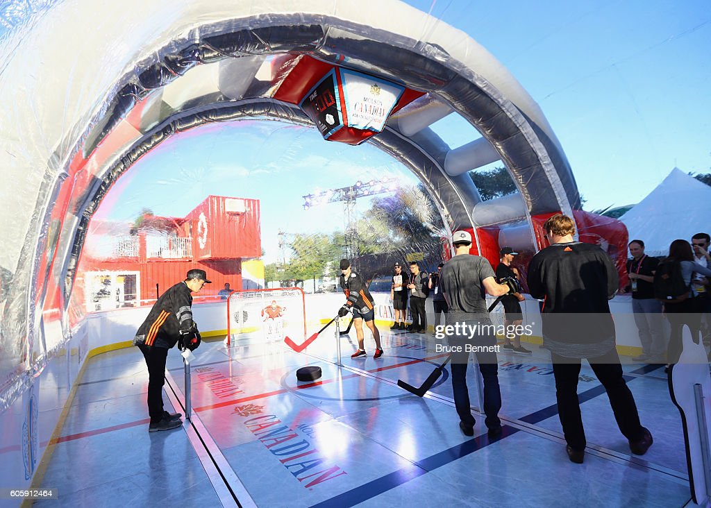 Johnny Gaudreau, Dylan Larkin, Ryan Nugent-Hopkins and Morgan Reilly of Team North America play bubble hockey at the Scotiabank Fan Village prior to it's opening as part of the World Cup of Hockey festivities on September 15, 2016 in Toronto, Canada.