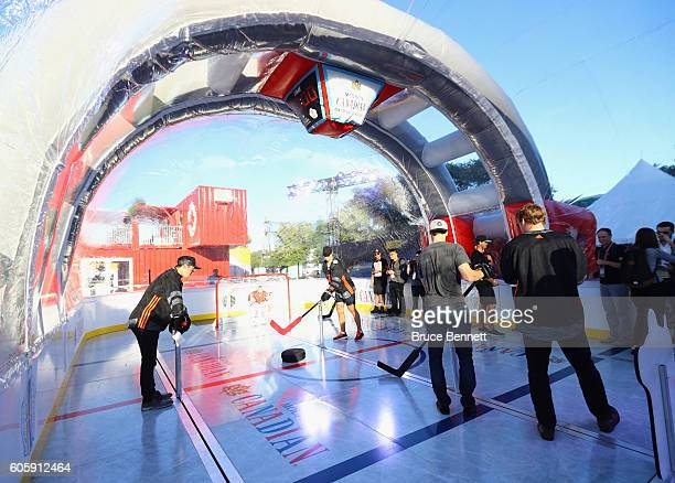 Johnny Gaudreau Dylan Larkin Ryan NugentHopkins and Morgan Reilly of Team North America play bubble hockey at the Scotiabank Fan Village prior to...