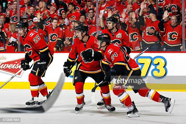 Johnny Gaudreau Jiri Hudler Sean Monahan and Kris Russell of the Calgary Flames celebrate a goal against the Vancouver Canucks at Scotiabank...