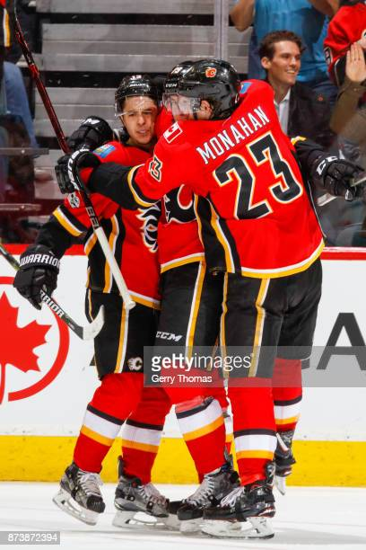 Johnny Gaudreau Micheal Ferland and Sean Monahan of the Calgary Flames of the Calgary Flames celebrate in an NHL game against the St Louis Blues at...