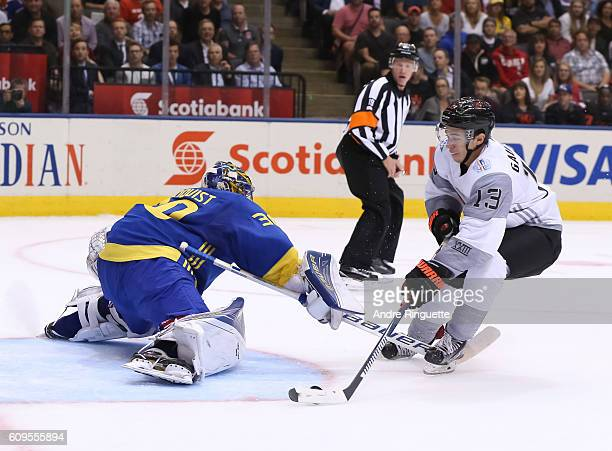 Johnny Gaudreau of Team North America stickhandles the puck around Henrik Lundqvist of Team Sweden to score a first period goal during the World Cup...