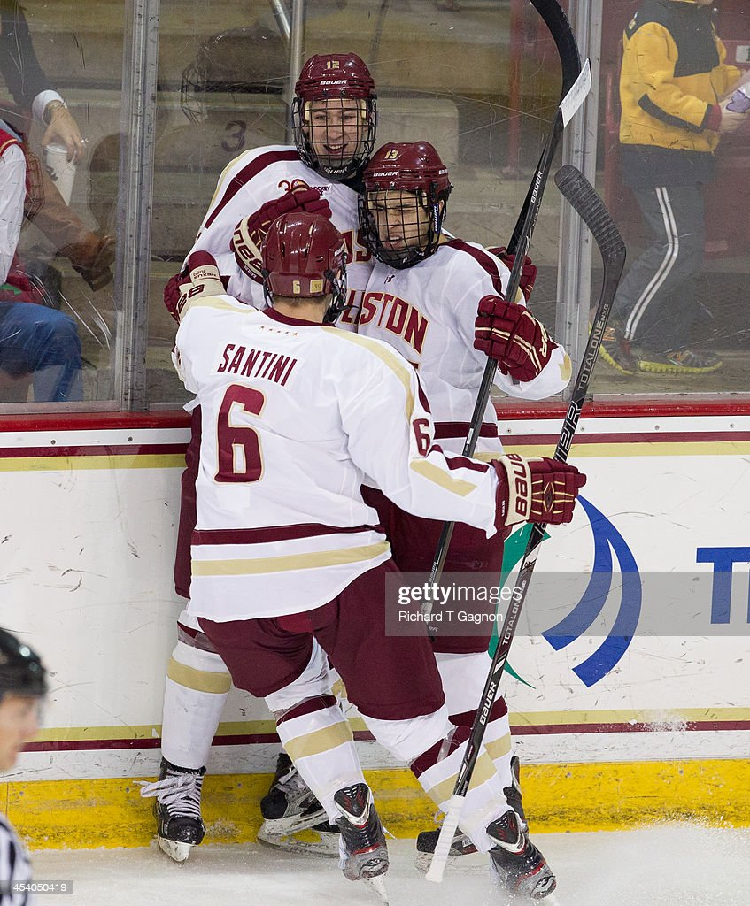 Johnny Gaudreau #13 of the Boston College Eagles celebrates his first period goal with teammates Kevin Hayes #12 and Steve Santini #6 during NCAA hockey action against the New Hampshire Wildcats at the Kelley Rink on December 6, 2013 in Chestnut Hill, Massachusetts.