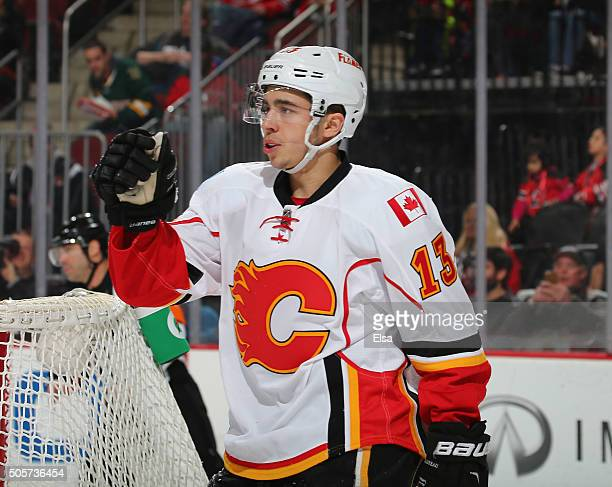 Johnny Gaudreau of the Calgary Flames celebrates a goal by teammate Sean Monahan in the first period against the New Jersey Devils on January 192016...