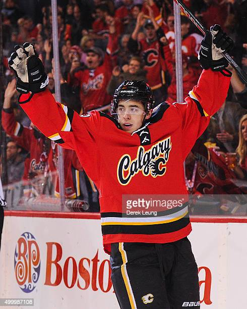 Johnny Gaudreau of the Calgary Flames celebrates after scoring against the Boston Bruins during an NHL game at Scotiabank Saddledome on December 4...