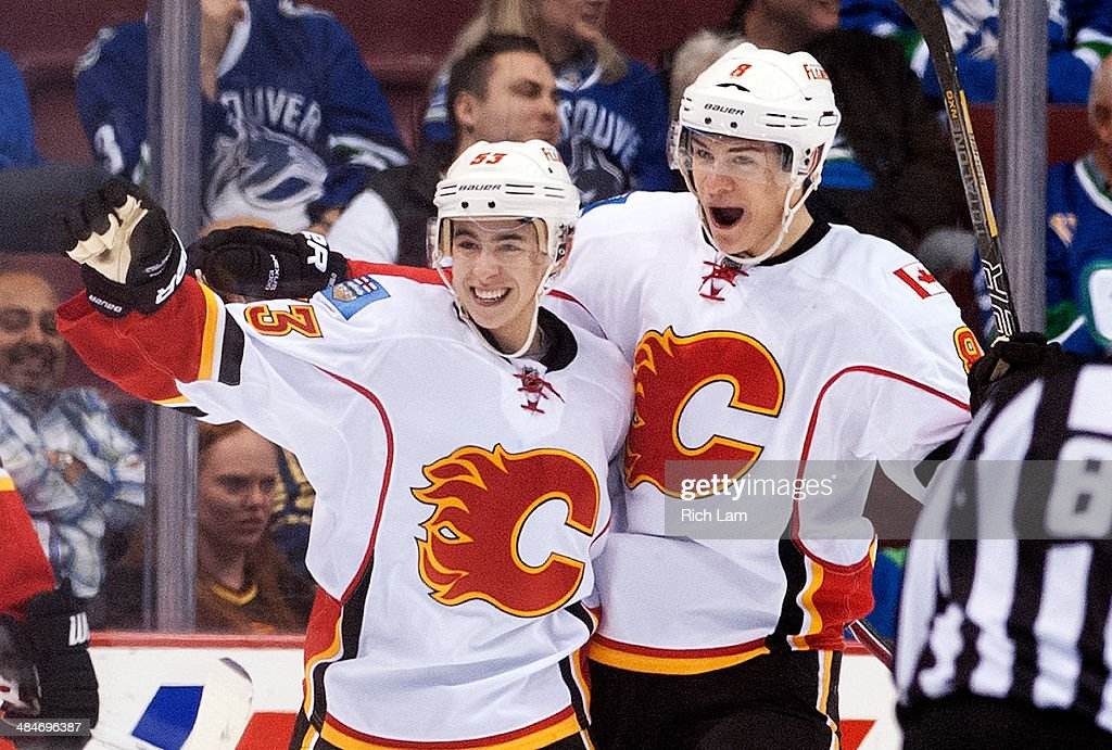 Johnny Gaudreau #53 of the Calgary Flames celebrates with teammate Joe Colborne #8 after scoring his first NHL goal against the Vancouver Canucks during the second period in NHL action on April 13, 2014 at Rogers Arena in Vancouver, British Columbia, Canada.