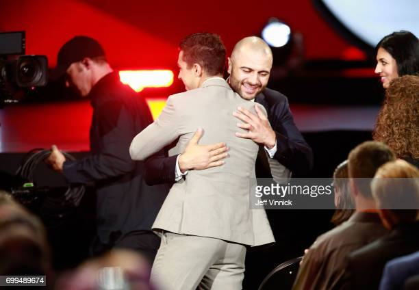 Johnny Gaudreau of the Calgary Flames left is hugged by teammate Mark Giordano after Gaudreau was awarded the Lady Byng Memorial Trophy during the...