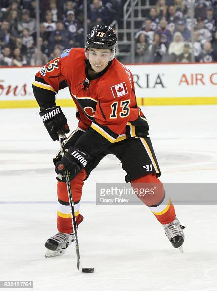 Johnny Gaudreau of the Calgary Flames plays the puck down the ice during third period action against the Winnipeg Jets at the MTS Centre on January 9...