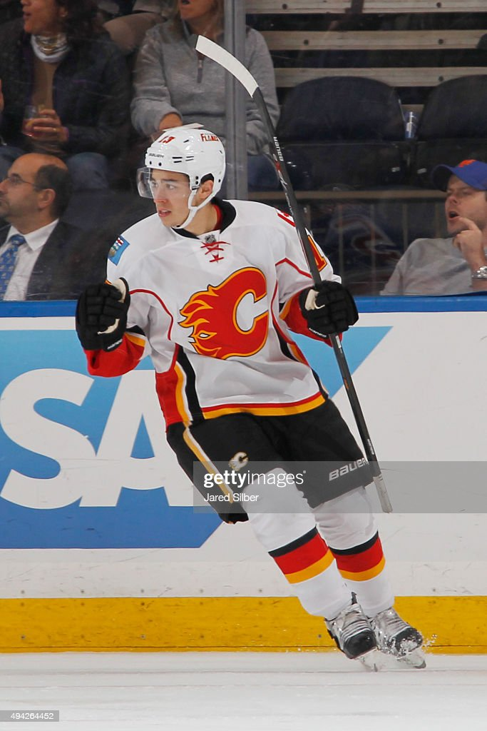 <a gi-track='captionPersonalityLinkClicked' href=/galleries/search?phrase=Johnny+Gaudreau&family=editorial&specificpeople=8953159 ng-click='$event.stopPropagation()'>Johnny Gaudreau</a> #13 of the Calgary Flames reacts after a goal from Jiri Hudler #24 (not pictured) in the first period against the New York Rangers at Madison Square Garden on October 25, 2015 in New York City.