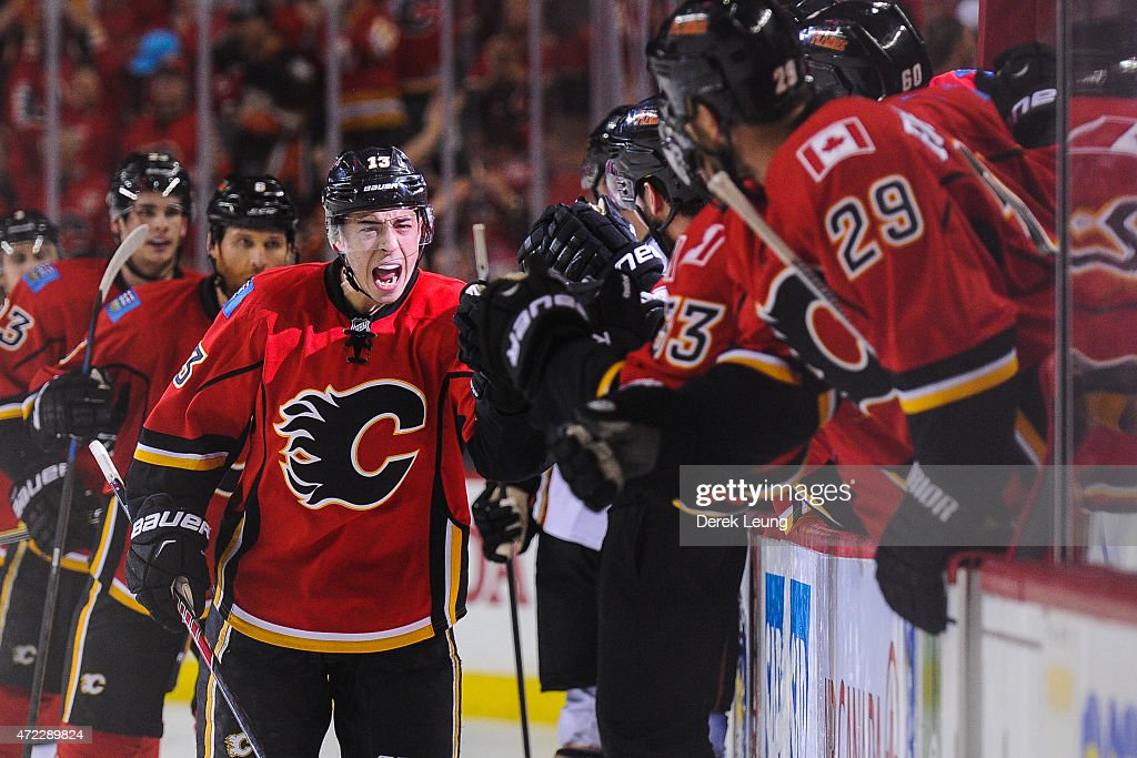 Johnny Gaudreau of the Calgary Flames scores against the Anaheim Ducks to tie the game in Game Three of the Western Conference Semifinals during the...