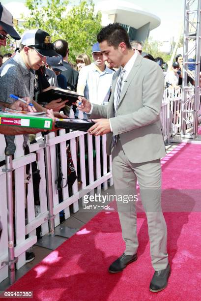 Johnny Gaudreau of the Calgary Flames signs autographs as he arrives on the magenta carpet for the 2017 NHL Awards at TMobile Arena on June 21 2017...