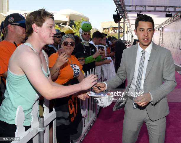Johnny Gaudreau of the Calgary Flames signs autographs for fans as he attends the 2017 NHL Awards at TMobile Arena on June 21 2017 in Las Vegas Nevada