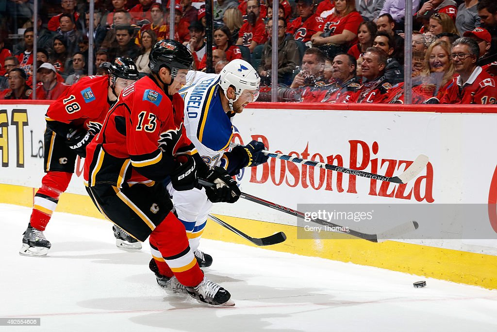 Johnny Gaudreau #13 of the Calgary Flames skates against Alex Pietrangelo #27 of the St. Louis Blues during an NHL game at Scotiabank Saddledome on October 13, 2015 in Calgary, Alberta, Canada.