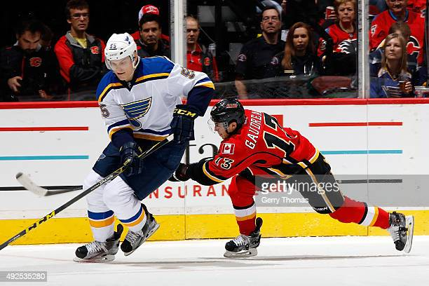 Johnny Gaudreau of the Calgary Flames skates against Colton Parayko of the St Louis Blues during an NHL game at Scotiabank Saddledome on October 13...