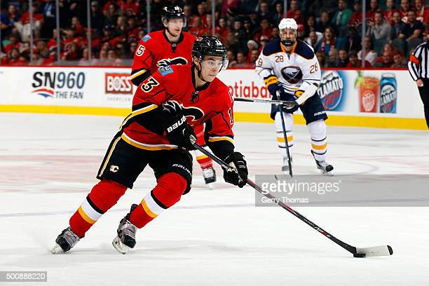 Johnny Gaudreau of the Calgary Flames skates against the Buffalo Sabres during an NHL game at Scotiabank Saddledome on December 10 2015 in Calgary...