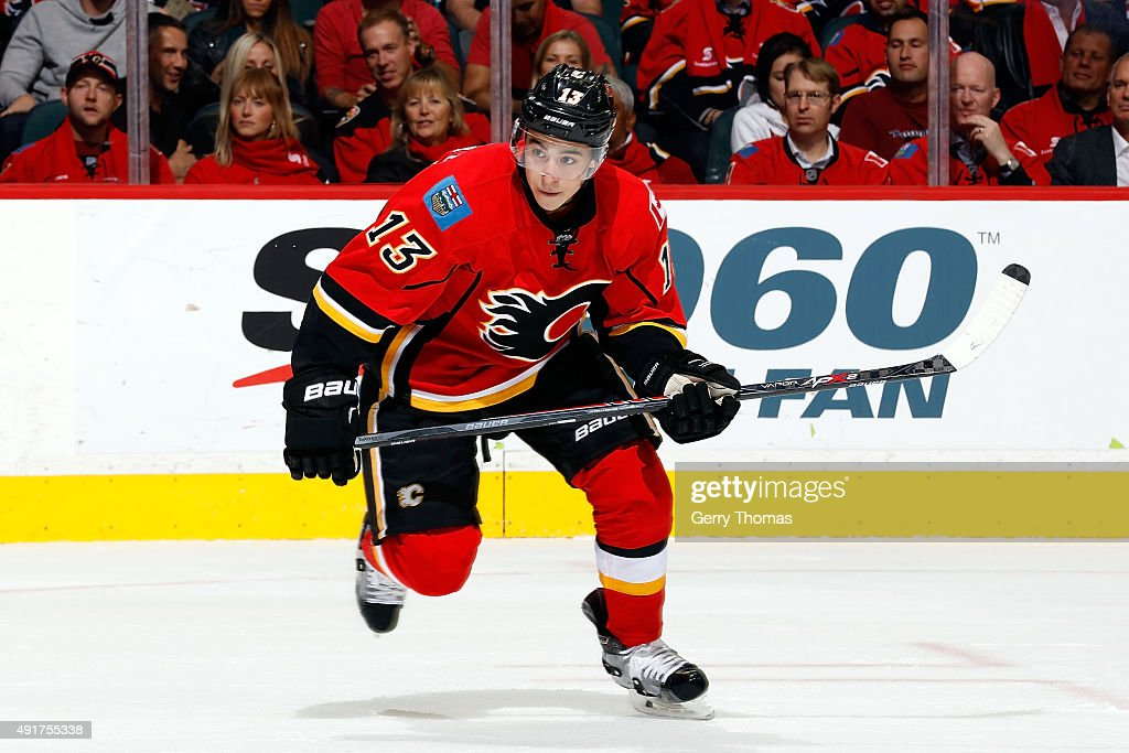 <a gi-track='captionPersonalityLinkClicked' href=/galleries/search?phrase=Johnny+Gaudreau&family=editorial&specificpeople=8953159 ng-click='$event.stopPropagation()'>Johnny Gaudreau</a> #13 of the Calgary Flames skates against the Vancouver Canucks at Scotiabank Saddledome during the NHL season opener on October 7, 2015 in Calgary, Alberta, Canada.